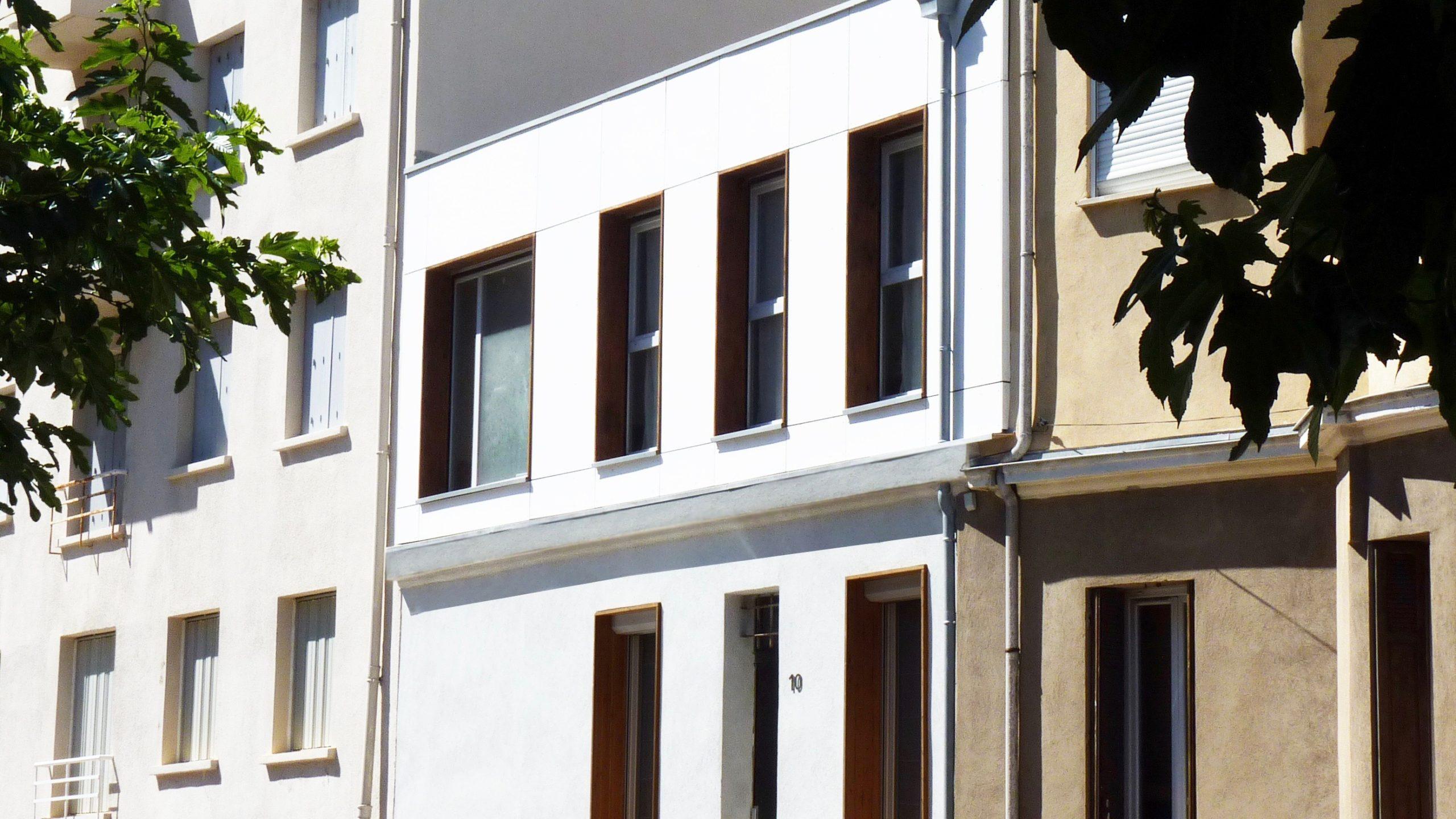 Surélévation d'une maison de ville «les trois trios»